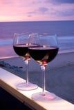 Coucher du soleil de plage de vin rouge Photographie stock