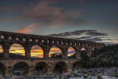 Coucher du soleil de Ponte du le Gard Photographie stock
