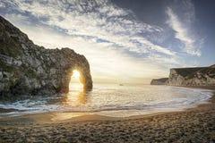 Coucher du soleil de porte de Durdle Images stock
