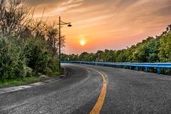 Coucher du soleil de route Photos libres de droits