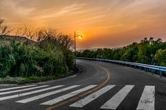 Coucher du soleil de route Photo stock