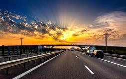 Coucher du soleil de route Photographie stock libre de droits