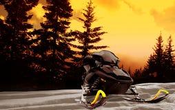 Coucher du soleil de Snowmobile Photographie stock