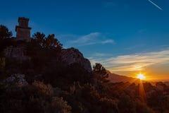 Coucher du soleil de tour de montre photographie stock libre de droits
