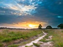 Coucher du soleil de traînée de lande photos libres de droits