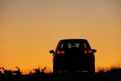 Coucher du soleil de véhicule Photographie stock libre de droits
