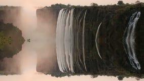 Coucher du soleil de Victoria Falls avec la réflexion mystique banque de vidéos