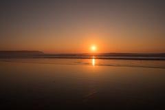 Coucher du soleil de Woolacombe photographie stock libre de droits