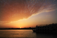 Coucher du soleil du Nil Photographie stock libre de droits