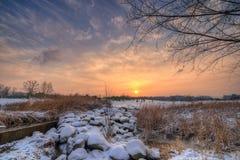 Coucher du soleil en hiver Photographie stock libre de droits
