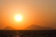 Coucher du soleil en mer Image libre de droits