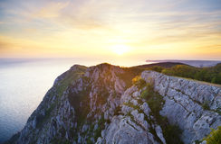 Coucher du soleil en montagnes de taille Photographie stock