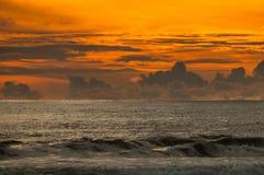 Coucher du soleil en plage dominicale Photos stock