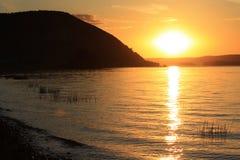 Coucher du soleil en rivière Images stock