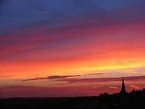 Coucher du soleil et église Photos libres de droits