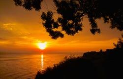 Coucher du soleil et les trois Images stock