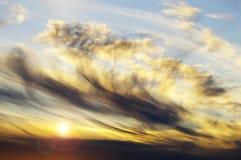 Coucher du soleil et nuages Image libre de droits