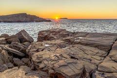Coucher du soleil et roches Photos libres de droits