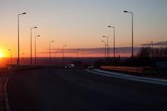 Coucher du soleil et route photographie stock libre de droits