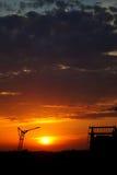 Coucher du soleil industriel Photographie stock
