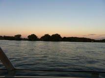 Coucher du soleil la rivière Zambesi Photos stock