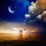 Coucher du soleil, mer et lune Photo libre de droits