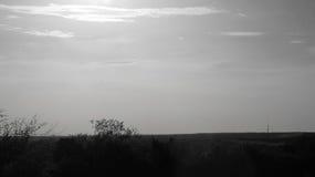 Coucher du soleil noir et blanc photos stock