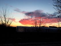 Coucher du soleil nuageux Image libre de droits