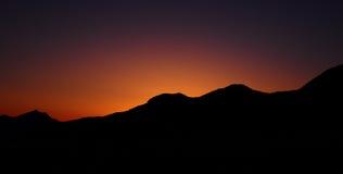 Coucher du soleil panoramique de silhouette Photo stock
