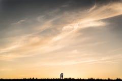 Coucher du soleil partagé Photographie stock