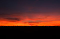 Coucher du soleil pourpre de l'Argentine de rouge orange Images stock