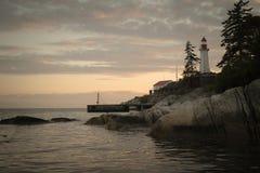 Coucher du soleil rêveur de phare Photos libres de droits