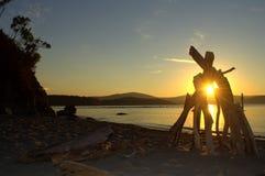 Coucher du soleil reculé de plage Image stock