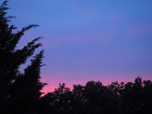 Coucher du soleil rosâtre Photographie stock