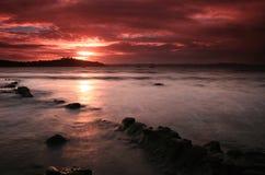 Coucher du soleil rouge de ciel Photos libres de droits