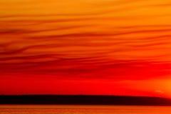 Coucher du soleil rouge de ciel Images stock