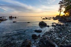 Coucher du soleil secret de plage Photographie stock