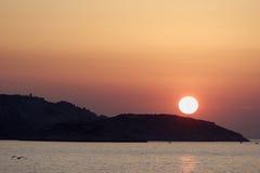 Coucher du soleil sur l'île Photographie stock