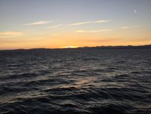 Coucher du soleil sur l'océan Photos stock