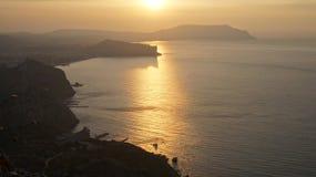 Coucher du soleil sur la côte images libres de droits