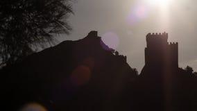 Coucher du soleil sur la forteresse Genoese sur la colline Photographie stock libre de droits