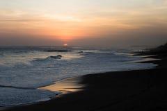Coucher du soleil sur la plage de Kuta Photographie stock