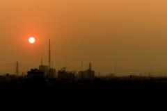 Coucher du soleil sur la ville Photographie stock libre de droits