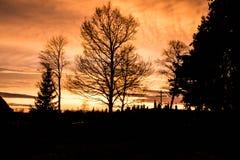Coucher du soleil sur le cementary Photographie stock