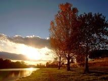 Coucher du soleil sur le fleuve Photo libre de droits