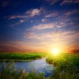Coucher du soleil sur le fleuve Image libre de droits