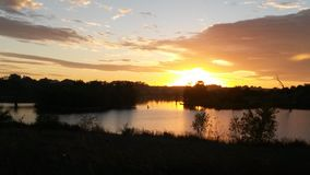 Coucher du soleil sur le lac Photos stock