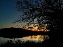 Coucher du soleil sur le lac indien Image libre de droits