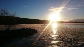 Coucher du soleil sur le lac Siljan Image libre de droits