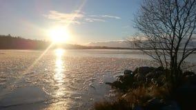 Coucher du soleil sur le lac Siljan Image stock